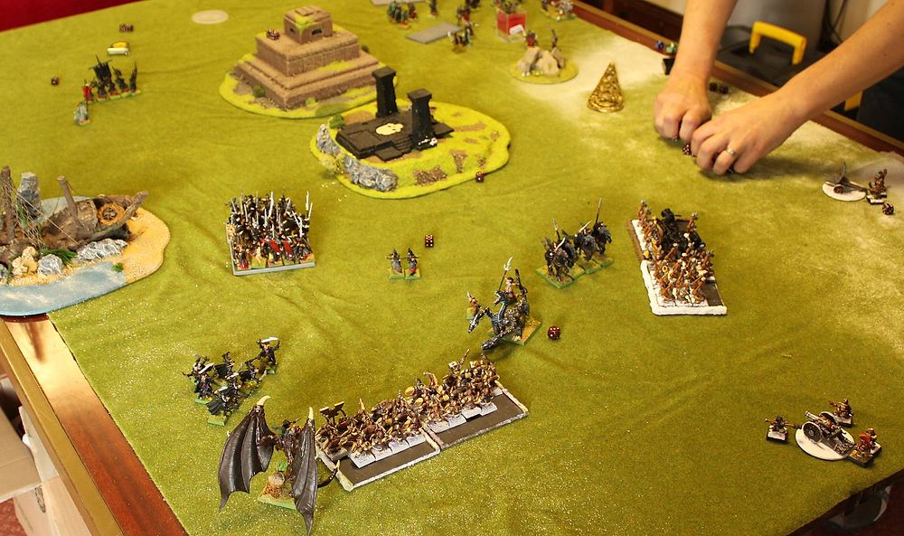 A game of Warhammer Fantasy Battles being played between Dark Elves and Dwarves