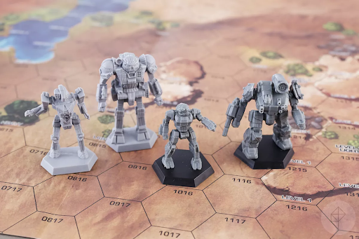 A lance of BattleTech mechs arrayed on the game's hex grid map.