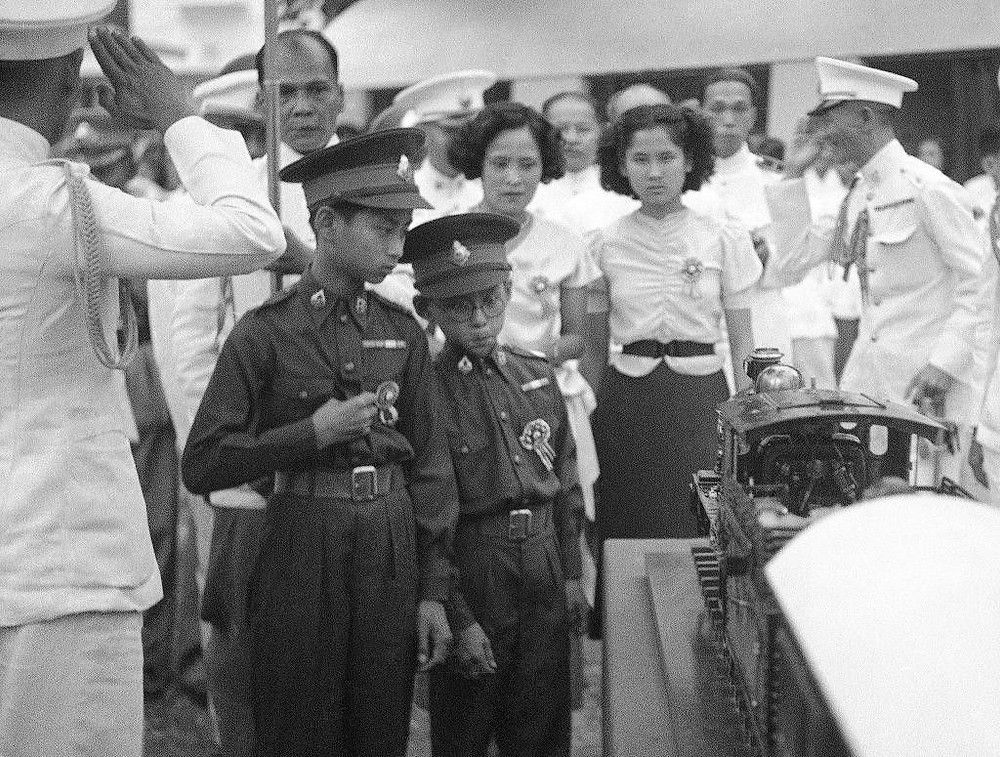 King Ananda at age 13, and his brother, Prince Bhumibol (AP Photo)