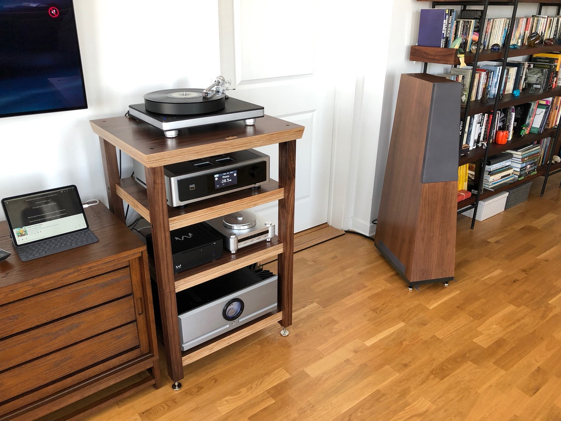 I wanted to let you know that the isoPLAT arrived safely yesterday. The quality of your craftsmanship is beautiful, I love the finish and the walnut is lovely. I can't wait to get my new turntable set up on it. I'll let you know when I have all that done and send another photo. Have to say I'm thrilled with this. Thank you also for the note, very kind.  Best regards,  Andrew  Evening Arnold,  Just wanted to let you know I put together the 4L this morning and installed all my components. I'm so pleased with how it came out. Your craftsmanship, once again is superb, and the fit and finish of the parts is excellent. I love the design, the materials, the engineering and that it has been made to measure for my system. I'm so glad I found your company and really enjoy our conversations. I have to comment on the packaging too. I don't think I have ever received anything so well packed as this. Each part was wrapped and suspended in foam, then hard card on the corners. These packages travelled right across the country and there was no issue whatsoever. If anyone ever has any concerns about shipping they shouldn't! I did want to let you know that the floor protection coasters were missing from the parts kit. I've borrowed the ones from the isoPlat for now, but if you could send me a set that would be great.  I have attached a few pictures of it's current set-up. Thank you again, Best regards,  Andrew Chattaway Chicago, IL