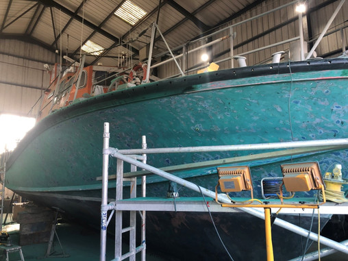 Green topsides start to be stripped down and sanded ready for the first coat. Her transformation has started!