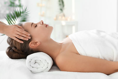 Young woman enjoying massage in spa salo