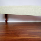 Upholstery of a vintage footstool