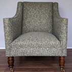 Upholstery of a grey chair with customer