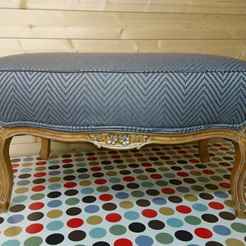 Upholstery of a vinatge footstool