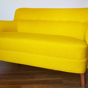 Upholstery of a yellow sofa.jpeg