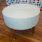 Upholstery of a grey footstool