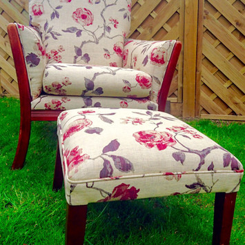 Upholstery of an armchair and a footstool in the same floral fabric
