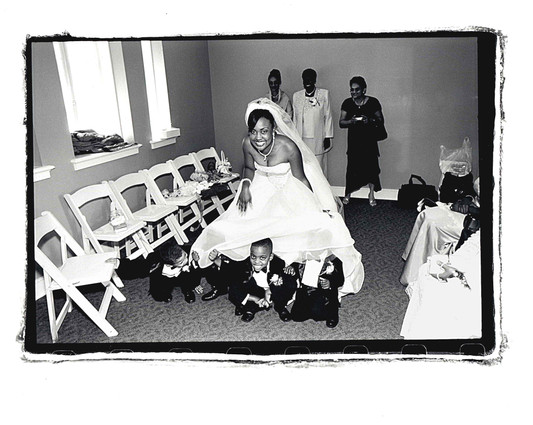 Kids under brides dress