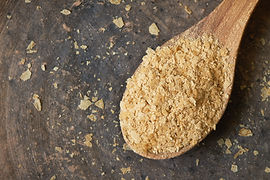 Nutritional brewers yeast flakes in wood
