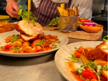 Crispy chicken stuffed with smoked Applewood, ham and sage, with garlic potatoes and a tomato salsa