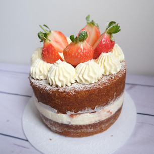Classic Victoria Sponge With Cream and Strawberries