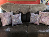 Swirl pillows on couch.jpg