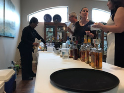 Dee rocking her bartending mastery at th