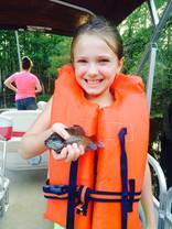 Maddison holding fish