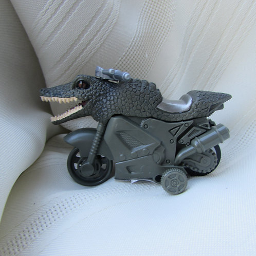 Alligator friction powered motorcycle