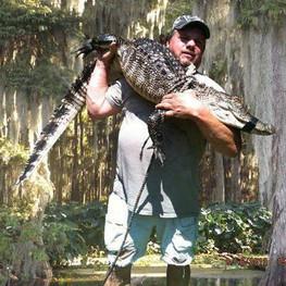 P'Maw holding gator.