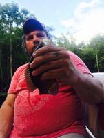 P'Maw holding fish