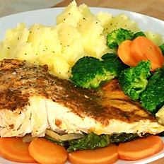 Salmon served with mash potatoes and vegetables