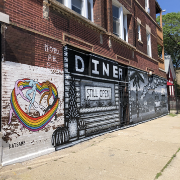 Pride 2021 Mural next to a Nick Fisher Mural