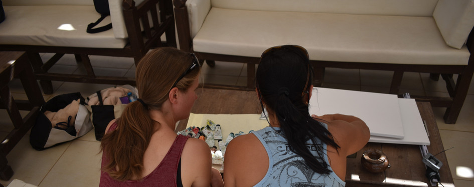 Olga Nikitina, a techer of underwater painting. PADI scuba instructor, explains to he student how to use the canvas underwater.