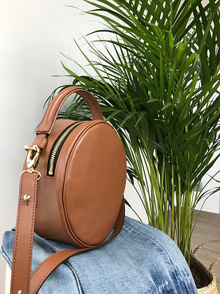 Round bag in cognac hued leather