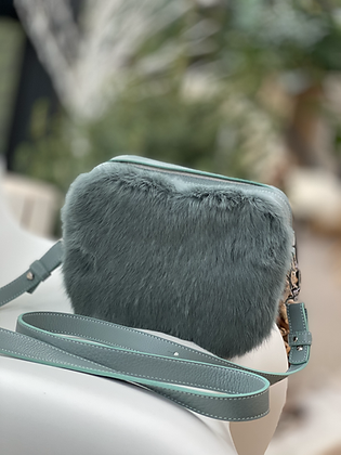 Camera-bag style in aqua-hued leather and a touch of fur