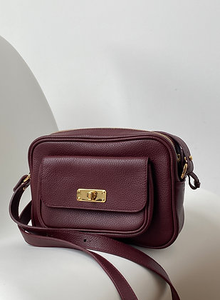 Camera bag in burgundy coloured leather
