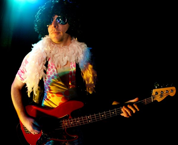 Disco Inferno bassist