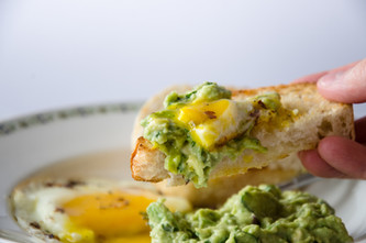 fried eggs with guacamole & chili oil
