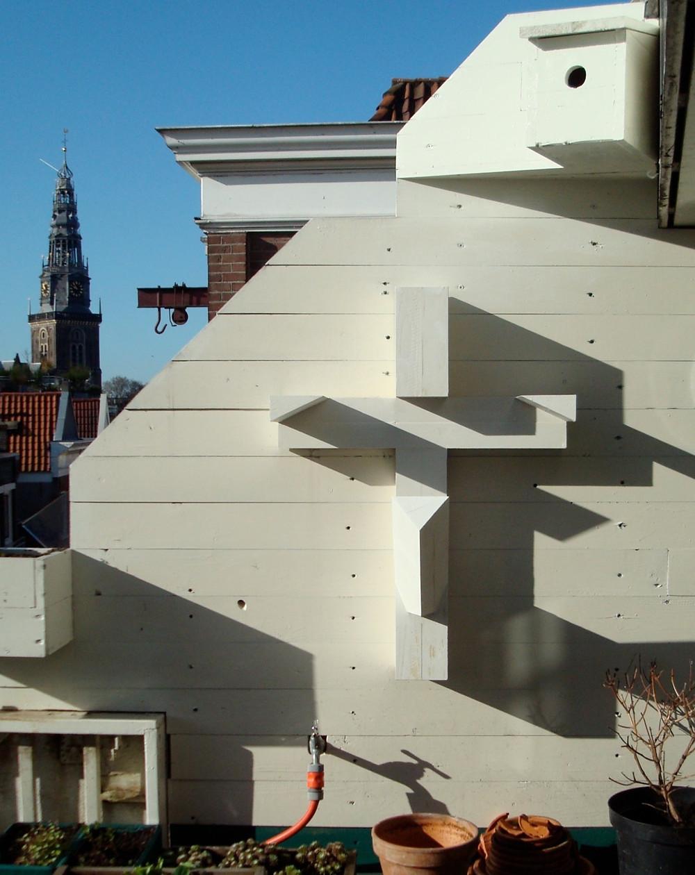 A cross sculpure by Keith Milow in Warmoesstraat, Amsterdam. NL.