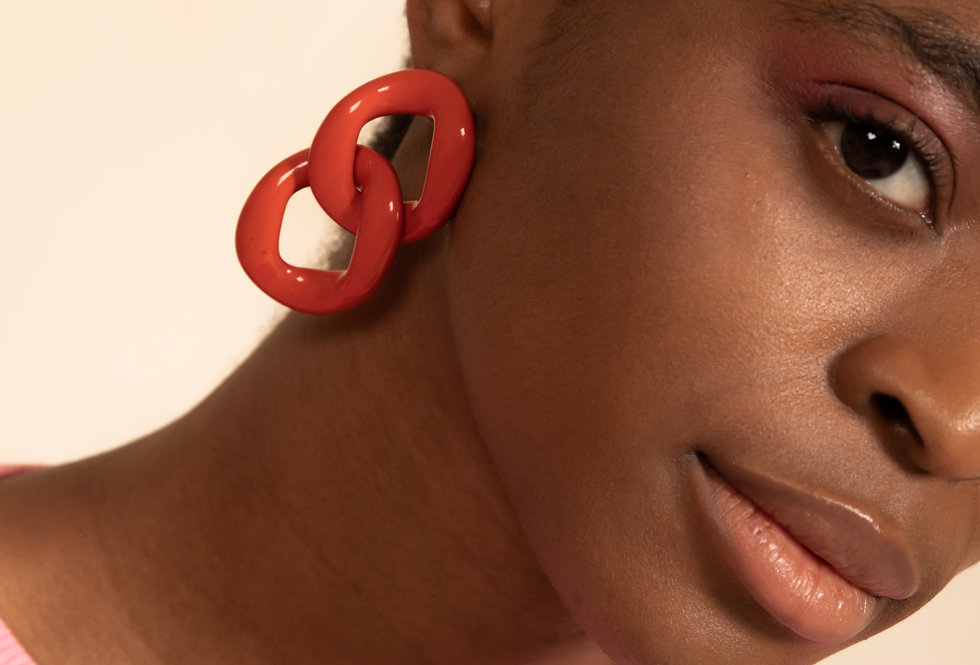Con earrings coral