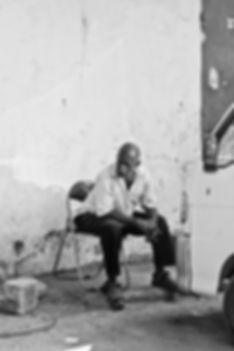 Zanzibar Stone Town man waiting citizen black and white