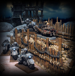 Puppetswar (left), Wargame Exclusive (right) Ramparts by Printable Scenery