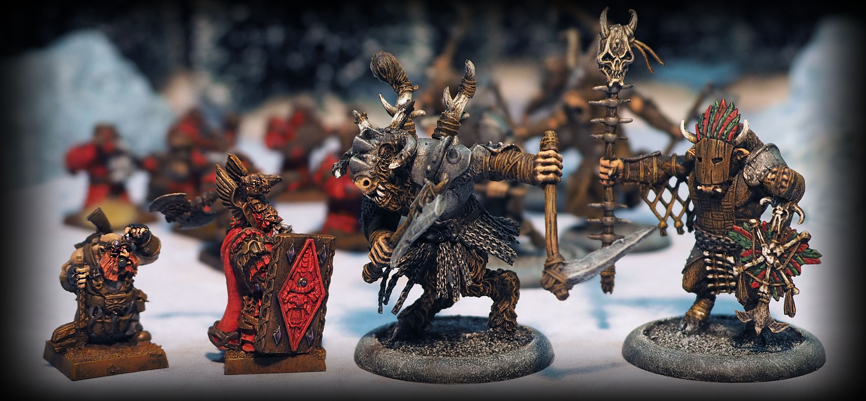 Avatars of War (left) and Megalith Games (right)