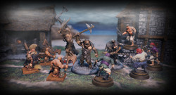Avatars of War (left), Megalith Games (mid) and Firelock Games (right), Terrain by Zealot Miniatures