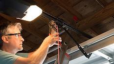 Man in glasses installing garage door.jp