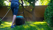 Man mowering his lawn.jpg