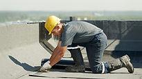 Man installing roof felth.jpg
