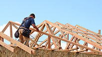 Man working on house roof.jpg