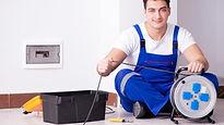 Electrician in blue jumpers.jpg