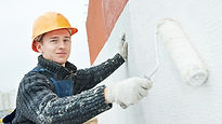 Handyman painting the wall white.jpg