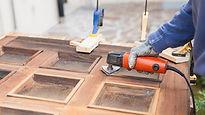 Fixing the wooden garage door.jpg