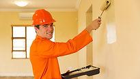 Painter in orange overalls.jpg