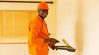 Black handyman in orange overalls.jpg