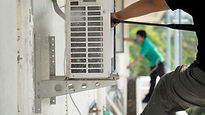 People Installing Air Conditioning Syste