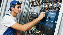 Young man working with fuse box.jpg