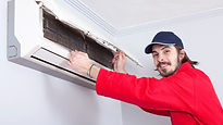 Man in red suit installing AC unit.jpg