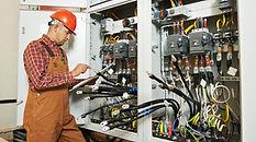 Electrician in orange jumpsuit.jpg