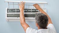 Man cleaning the air conditioning system